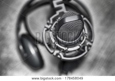 Microphone and headphones in musical recording studio