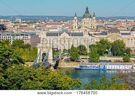 View of Chain Bridge, Gresham Palace, St Stephen Basilica and the Danube River from the Castle Hill of Budapest
