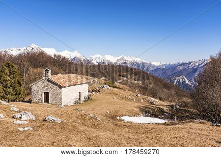 Chapel on Monte San Simeone with Julian Alps in the background