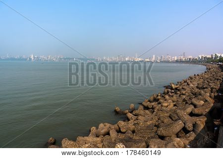 View Of The Embankment Of Mumbai With Large Stones And Sky.