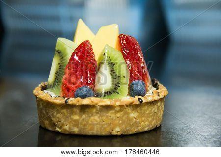 Mixed fruit tart. A custard base tart filling with various fruits