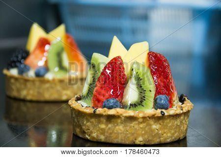 Mixed fruit tart. A custard base tart filling with various fruits on top.