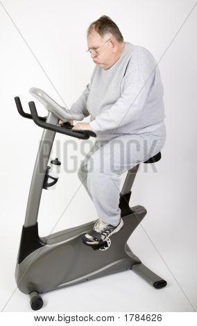 Big Guy Huffing On The Bike