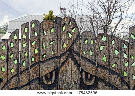 Old wooden fence with carved glass windows