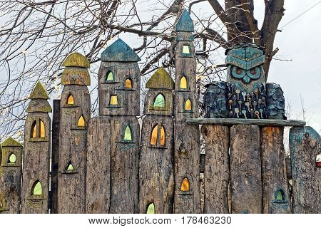 Wooden fence and wooden owl with keys
