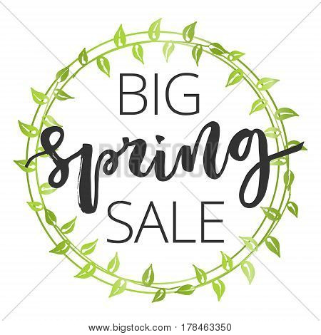 Big spring sale hand written inscription with green floral wreath on white background