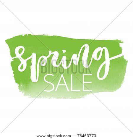 Spring sale white hand written inscription on green watercolour banner background