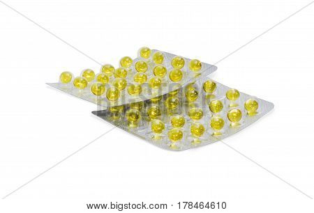 Two blister packs with a pharmaceutical drug in the form of yellow pills on a light background