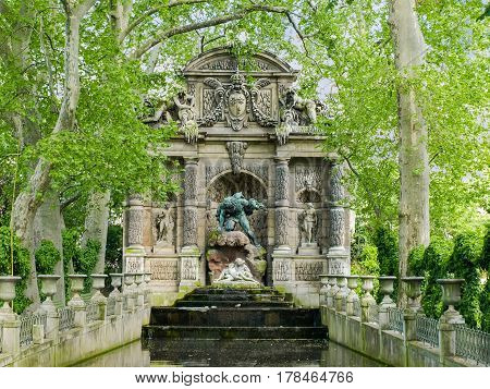 Medici Fountain built in 1620 closeup in the Luxembourg Garden in Paris in springtime