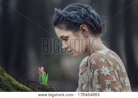 Portrait Of Sensual Young Woman Wearing Elegant Dress In A Coniferous Forest.