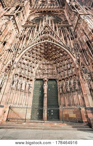 Delicate decoration at facade of the Notre Dam of Strasbourg Cathedral in Strasbourg France
