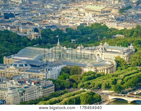 View from the Eiffel Tower to the Great Palace and Small Palace built in 1900 among the flowering chestnuts in the springtime in Paris