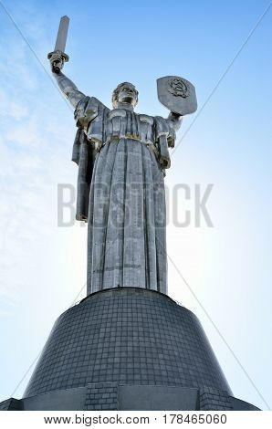 Monument Rodina Mother on the background of the blue sky. Communist symbol of the totalitarian Soviet regime in Kiev Ukraine.