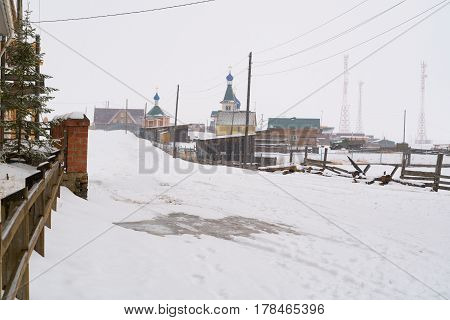 View of Saint Nicholas Church and a small village of Goloustnoye at Lake Baikal in Russia
