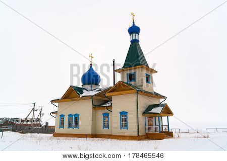 Winter view of St Nicholas Church on the shore of Lake Baikal in the village of Great Goloustnoye in Russia