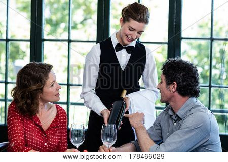 Couple selecting a bottle of wine in restaurant