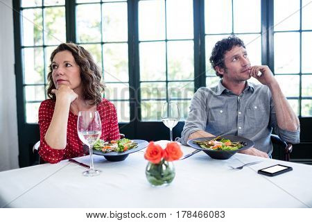 Woman feeling bored and ignoring each other in restaurant