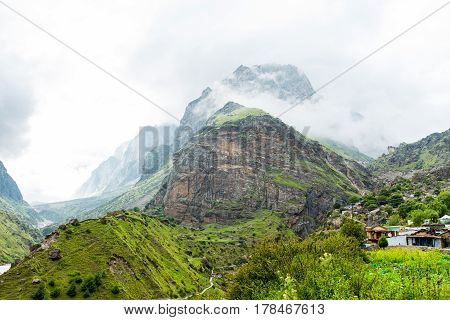 View of mountain in the mist and village at Mana Uttarakhand India