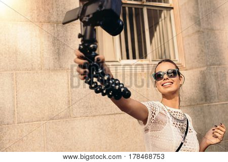 Young Tourist Recording Selfie Video While Walking In The Street