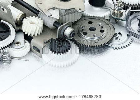 Parts Of Industrial Equipment. Plastic Gears And Cogwheels On Scratched Metal Background.
