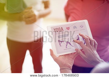 People studying yoga positions on a tablet