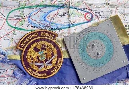 Chevron of Ukraine army.Back-Map of Ukraine  with location of Balakleya .Place of arsenal explosion at 23 march. 138 kT. of TNT power.March 25 ,2017 in Kiev, Ukraine