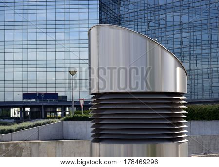 metal pipe ventilation despite the large glass building