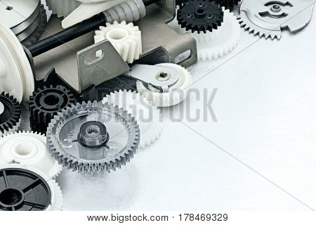 Scratched Metal Industrial Background With Plastic Cogwheels And Machine Parts