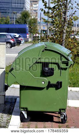 large green plastic containers for the disposal of garbage