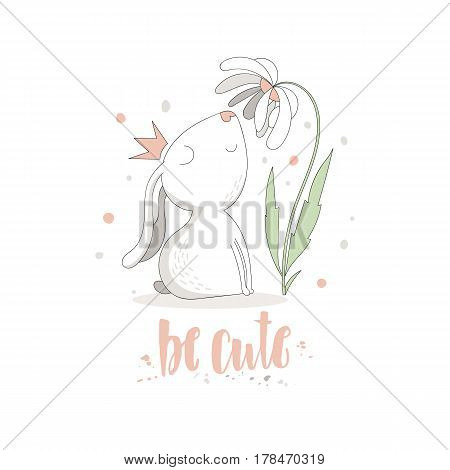 Cute smiling rabbit with a crown looks at the flower and a hand written inscription