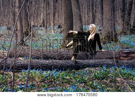 the girl in the spring forest, snowdrops in their hair, a fabulous image