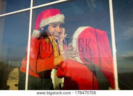 Two cute boys brothers on window waiting for Santa and New Year