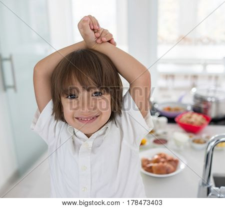 Excited smiling child in kitchen