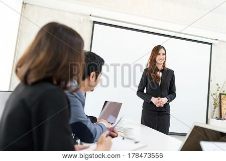 Business woman present the project to everyone