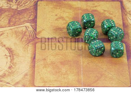Seven green dices with number six on them on the orange background