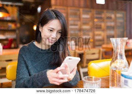 Woman working on cellphone