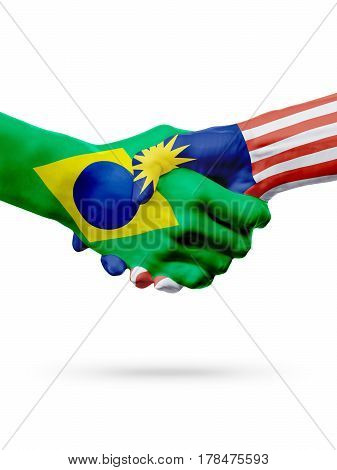 Flags Brazil Malaysia countries handshake cooperation partnership friendship or sports team competition concept isolated on white