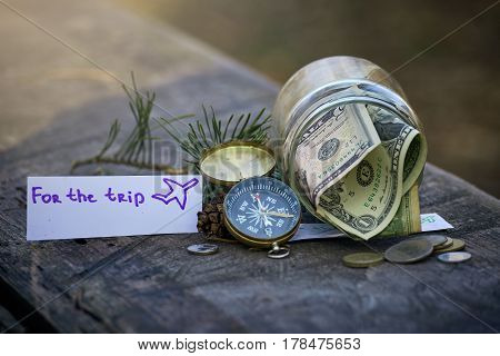 Accumulation of money in the piggy bank for travel.