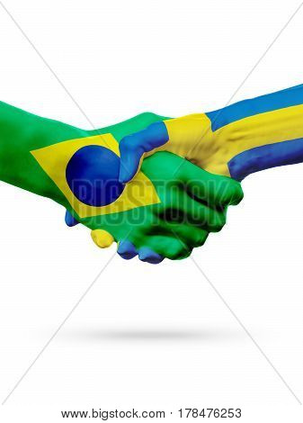 Flags Brazil Sweden countries handshake cooperation partnership friendship or sports team competition concept isolated on white