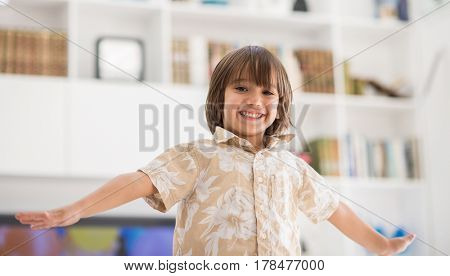 Happy children having fun and posing in new modern home
