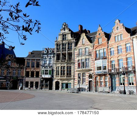 DENDERMONDE, BELGIUM, MARCH 27 2017: Historic buildings which surround the main Market Place (Grote Markt) in Dendermonde, a town in East Flanders, Belgium.