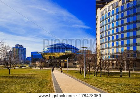 Minsk Belarus - March 23 2017 the house of the National Olympic Committee of the Republic of Belarus on Pobediteley Avenue against the blue sky modern architecture editorial