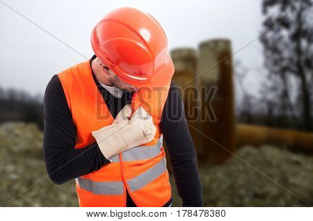 Young Construction Worker Having Chest Pain