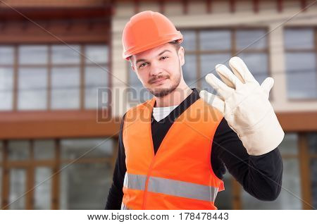 Young Engineer Showing Five Fingers