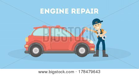 Car mechanic in uniform repairs engine at car service station.