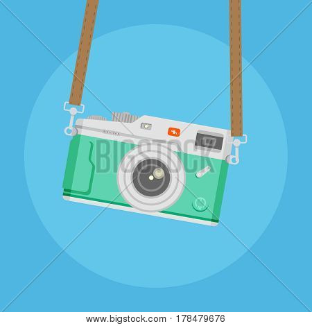 Green camera with brown strap on blue background vector concept. Retro photo camera illustration in modern flat style. Color picture for design web site, web banners, printed materials.