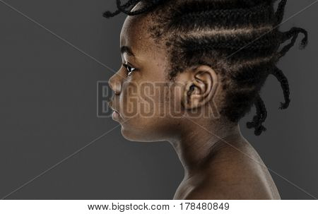 African little girl bare chest studio portrait in side view