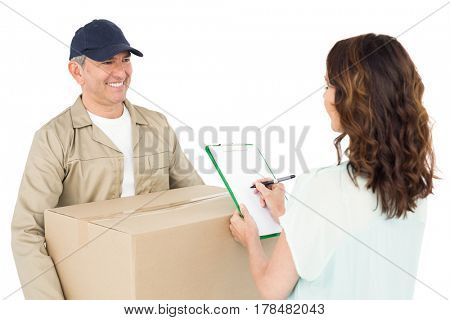 Happy delivery man giving package to customer on white background