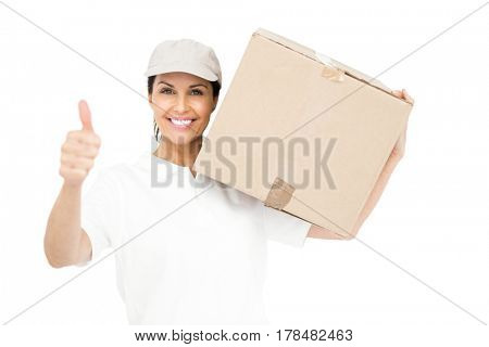 Delivery woman carrying a package and showing thumbs up on white background