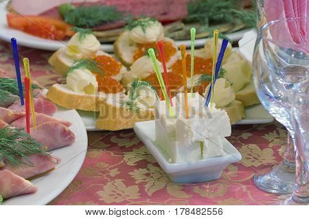 Canape with Pieces of feta cheese on a festive table